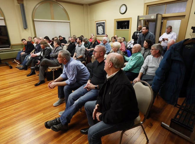Attendees listen at the Zanesville Board of Zoning Appeals votes on a special use permit for a sober living house in the Putnam neighborhood.