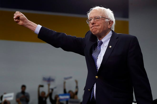 Democratic presidential candidate Sen. Bernie Sanders, I-Vt., arrives to speak to supporters at a primary night election rally in Manchester, N.H., Tuesday, Feb. 11, 2020. (AP Photo/Matt Rourke)