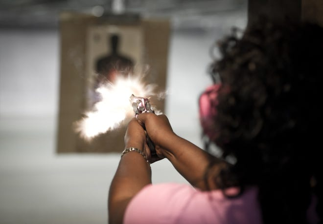 A woman practices at a shooting range outside Fredericksburg, Virginia, in April 2013.