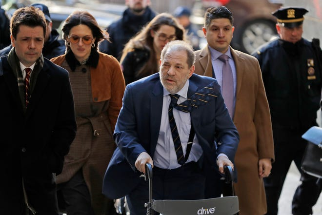 Harvey Weinstein arrives at court for prosecution closing arguments at his sex-crimes trial in New York, Feb. 14, 2020.