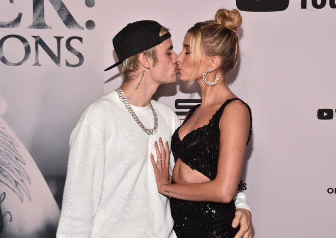 "Justin Bieber and Hailey Bieber attend the premiere of YouTube Original's ""Justin Bieber: Seasons"" at the Regency Bruin Theatre on January 27, 2020 in Los Angeles, California."