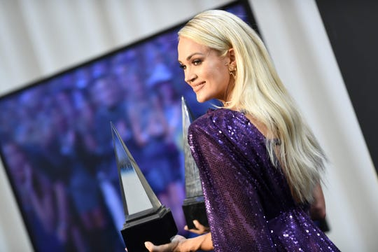 Carrie Underwood poses with her awards for Favorite Country Album and Favorite Female Country Artist in the press room during the 2019 American Music Awards at the Microsoft theatre on November 24, 2019 in Los Angeles.