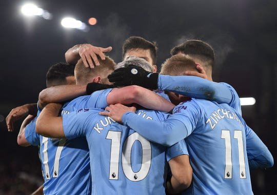Manchester City celebrates during a recent victory, however the team didn't have much to celebrate Friday after being banned from the Champions League for two years.