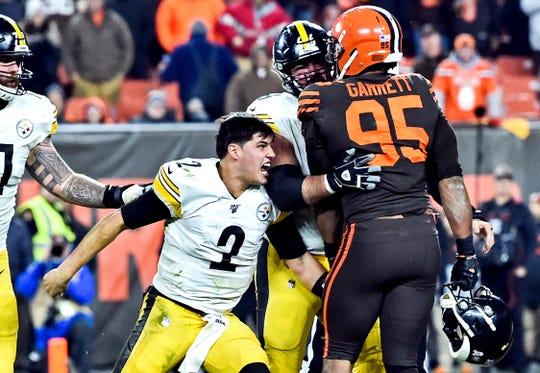 Cleveland Browns defensive end Myles Garrett and Pittsburgh Steelers quarterback Mason Rudolph during last November's brawl.