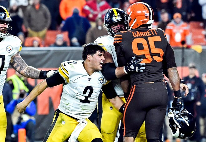 Cleveland Browns defensive end Myles Garrett and Pittsburgh Steelers quarterback Mason Rudolph during last November's brawl.