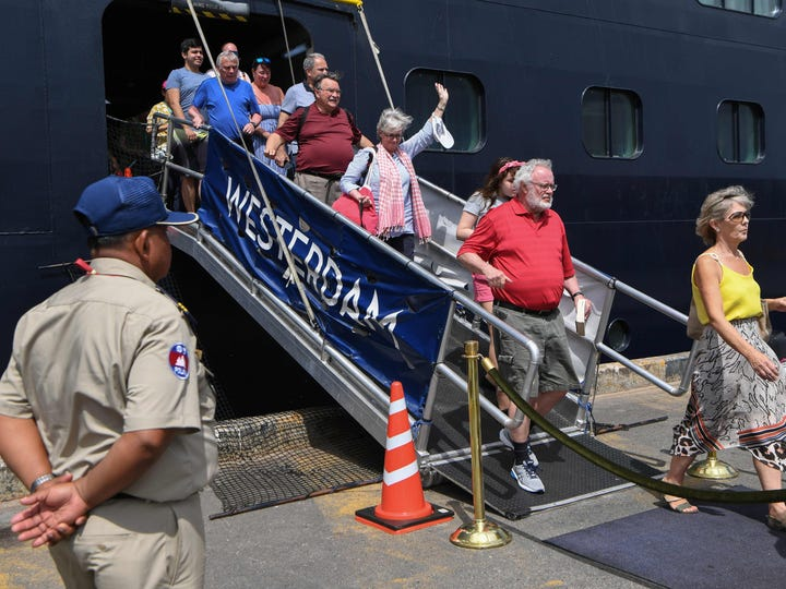 Passengers disembark from the Westerdam cruise ship in Sihanoukville.