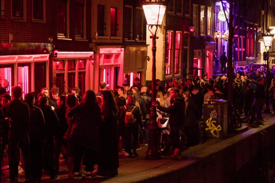 Some 115 guided tours pass through Amsterdam's infamous red-light district every day but starting in April, the windows of sex shops must be left off their itineraries.