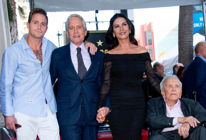 At the ceremony for Michael Douglas' star on the Hollywood Walk of fame on Nov. 6, 2018, the actor celebrated with his son Cameron, left, wife, Catherine Zeta-Jones, and father, Kirk Douglas.