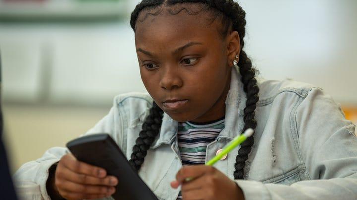 Eleventh grader Lanaie Mobley works on a problem during her Algebra II/Precalculus class at Burton High School in San Francisco.