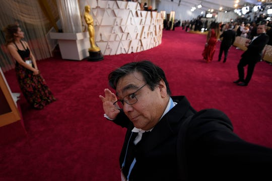 USA TODAY photographer Robert Hanashiro on the red carpet  at the 92nd Academy Awards after the stars have entered the Dolby Theatre.