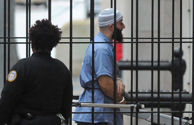 """FILE - In a Wednesday, Feb. 3, 2016 file photo, Adnan Syed enters Courthouse East in Baltimore prior to a hearing. The hearing, scheduled to last three days before Baltimore Circuit Judge Martin Welch, is meant to determine whether Syed's conviction will be overturned and case retried.  After spending 16 years in prison, Syed, convicted of murder, who was at the center of the podcast """"Serial"""" has won a new trial in Baltimore. Baltimore Circuit Judge Martin Welch ruled Thursday, June 30, 2016, that Syed deserves another trial because his attorney failed to cross-examine a cell tower expert about the reliability of data.   (Barbara Haddock Taylor/The Baltimore Sun via AP, File) WASHINGTON EXAMINER OUT; MANDATORY CREDIT /The Baltimore Sun via AP)  WASHINGTON EXAMINER OUT; MANDATORY CREDIT ORG XMIT: MDBAE501"""