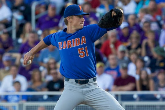 06/26/2017;  Omaha, NE, USA;  Pitcher Florida Gators Brady Singer (51) throws against the LSU Tigers in the first inning in a game of one of the 2017 Series of the College World Series at TD Ameritrade Park Omaha.  Mandatory credit: Bruce Thorson-USA TODAY Sport ORG XMIT: USATSI-360331 Original file ID: 20170626_sal_st5_118.JPG
