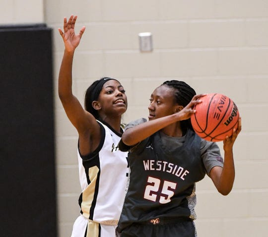 T.L. Hanna senior Carmen Chandler pressures Westside senior Keyshuna Fair during the third quarter at T.L. Hanna High School in Anderson Friday.