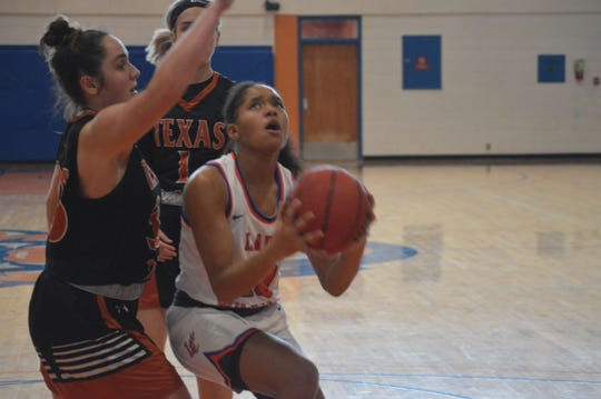 LC sophomore guard Kayla Kinney (10) goes up for two points against UT Dallas Saturday.