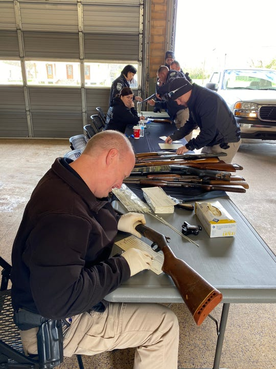 Each gun turned in during the city of Alexandria's gun buyback program was examined and tagged. Any gun received that was reported stolen will be returned to its owner.