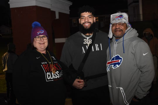 Cody Ford, a former Pineville High School football player who currently plays for the Buffalo Bills, served as the grand marshal of the City of Pineville's Night of Lights Mardi Gras Parade on Friday. He is shown here with his parents.