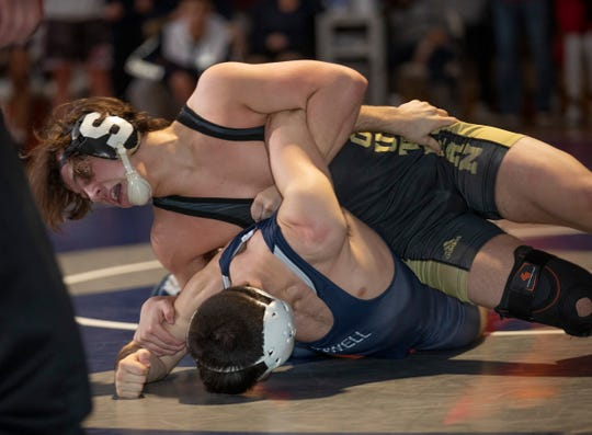 Southern's Cole Velardi works for the pin against Howell's Nick Acque in the 145-pound bout - the final bout of the NJSIAA South Group V championship match. Southern won 36-30