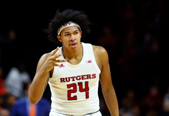 Rutgers Scarlet Knights guard Ron Harper Jr. (24) reacts after a three point shot against the Illinois Fighting Illini