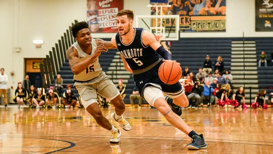 Monmouth guard George Papas (5) scored a career-high 32 points, including 20 in the second half, as the Hawks downed Canisius, 85-71, on Friday night in Buffalo, N.Y.