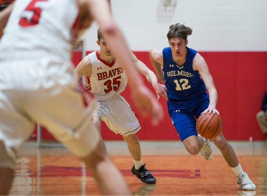 Holmdel vs Manalapan boys basketball.   