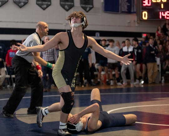 Southern freshman Cole Velardi celebrates after his pin in the 145-pound bout - the final bout of the match - gave Southern a 36-30 win over Howell in the NJSIAA South Group V championship match.