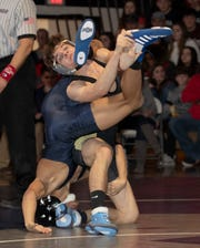 Southern's Matt Brielmeier (right) defeated Isaiah Fenton 7-4 in the second to last bout in Southern's 36-30 win over Howell in the NJSIAA South Group V championship match Friday night.