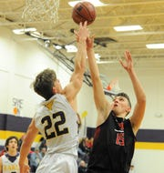 Early's Nathan Mitchell (22) blocks a shot attempt by Eastland sophomore Cooper Wright on Friday, Feb. 14, 2020, at Early High School.