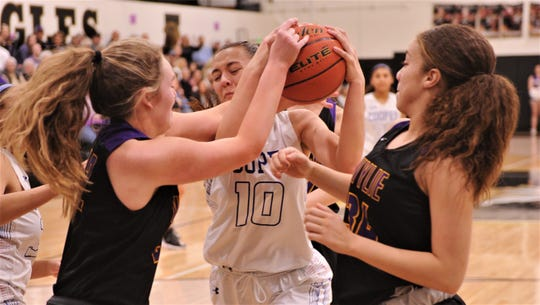 Cooper's Brianna Garcia (10) battles two Wylie players for a rebound. Cooper beat the Lady Bulldogs 46-42 in the District 4-5A seeding game for the No. 3 seed Friday, Feb. 14, 2020, at Abilene High's Eagle Gym.