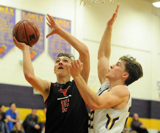 Eastland sophomore Cooper Wright goes for a shot as Early's Nathan Mitchell defends Friday, Feb. 14, 2020, at Early High School.