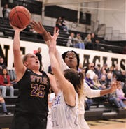 Wylie's Makinlee Bacon (25) shoots as Cooper's Dazz Larkins, right, and Meri Tetaj defend in the first half. Cooper beat the Lady Bulldogs 46-42 in the District 4-5A seeding game for the No. 3 seed Friday, Feb. 14, 2020, at Abilene High's Eagle Gym.