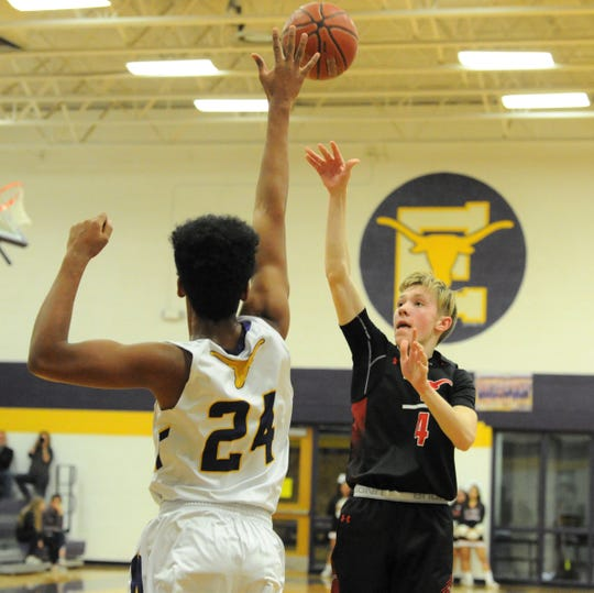 Eastland's Atley Johnson (4) goes for a floater over Early's Vic Cooper on Friday, Feb. 14, 2020, at Early High School.