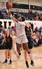 Cooper's Dazz Larkins (23) drives to the basket as Wylie's Bailey Roberts defends. Cooper beat the Lady Bulldogs 46-42 in the District 4-5A seeding game for the No. 3 seed Friday, Feb. 14, 2020, at Abilene High's Eagle Gym.