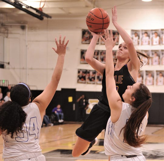 Wylie's Karis Christian drives to the basket over Cooper's Brianna Garcia, right, and Kaleigha Kemp. Cooper beat the Lady Bulldogs 46-42 in the District 4-5A seeding game for the No. 3 seed Friday, Feb. 14, 2020, at Abilene High's Eagle Gym.