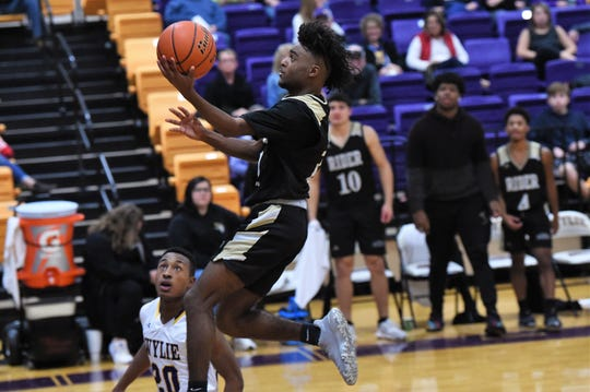 Wichita Falls Rider's Nick Darcus (11) goes up for a layup against Wylie at Bulldog Gym on Friday. Darcus led the No. 17 Raiders with 12 points as they held on for a 44-38 win.