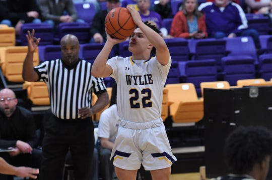 Wylie's Shayden Payne (22) lines up a shot against No. 17 Wichita Falls Rider at Bulldog Gym on Friday. Payne scored a game-high 15 points as Bulldogs came up just short in the 44-38 loss.