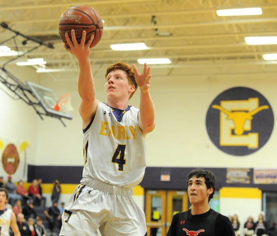 Early senior Timmy Smithson goes for a layup against Eastland on Friday, Feb. 14, 2020, at Early High School.