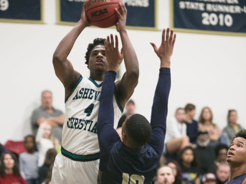 Asheville Christian Academy's Solomon Todd tries to score during the Lions' playoff game against Hickory Grove Christian on Feb. 15, 2020, in Swannanoa.