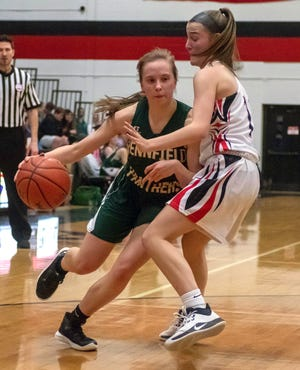 Pennfield's Isabelle Noffsinger (2) works to drive past a Marshall defender during game action Friday night.