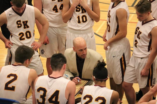 South Kitsap boys basketball coach Brian Cox talks to his team during Friday's 64-52 win over Rogers in a district tournament game at Stadium High School in Tacoma.