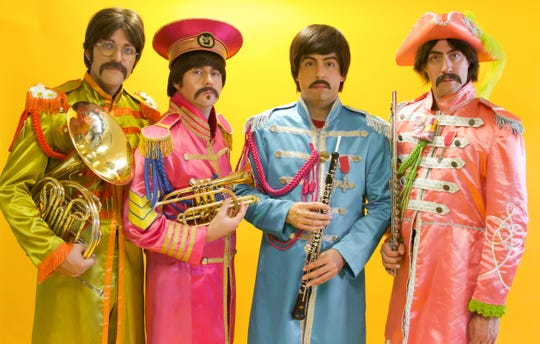 """Axel Clark (second from left) and the rest of Abbey Road in their """"Sgt. Pepper"""" costumes."""