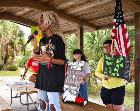Yvonne Mallory, a Heritage High senior, tells the Parkland memorial rally crowd about security threats that struck her school over the past year or so.
