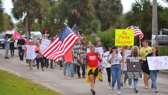 """About 10:45 a.m., Parkland rally attendees started chanting, """"No More Silence! End The Violence!"""" then departed the park and began walking up the causeway toward Indialantic."""