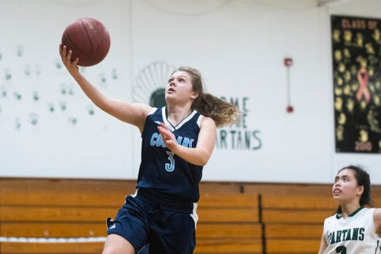MMU's Caitlyn Luitjens (3) leaps for a layup during the girls basketball game between the Mount Mansfield Cougars and the Winooski Spartans at Winooski High School on Friday night February 14, 2020 in Winooski, Vermont.