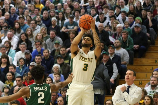 Vermont's Anthony Lamb puts up a 3-pointer in front of the Binghamton bench during a men's basketball game at Patrick Gym on Saturday, Feb. 15, 2020.