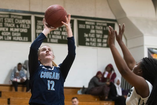 MMU's Sophia Farrell (12) takes a shot during the girls basketball game between the Mount Mansfield Cougars and the Winooski Spartans at Winooski High School on Friday night February 14, 2020 in Winooski, Vermont.