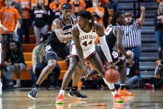 Feb 15, 2020; Stillwater, Oklahoma, USA; Texas Tech Red Raiders guard Chris Clarke (44) fights for position while defended by Oklahoma State Cowboys forward Cameron McGriff (12) during the first half at Gallagher-Iba Arena. Mandatory Credit: Rob Ferguson-USA TODAY Sports