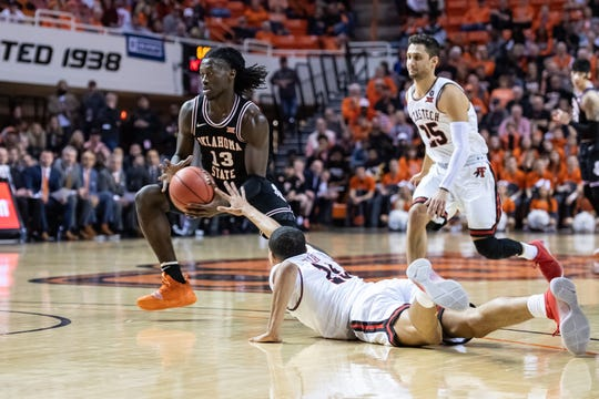 Feb 15, 2020; Stillwater, Oklahoma, USA; Texas Tech Red Raiders guard Kevin McCullar (15) reaches for the ball held by. Oklahoma State Cowboys guard Isaac Likekele (13) during the first half at Gallagher-Iba Arena. Mandatory Credit: Rob Ferguson-USA TODAY Sports