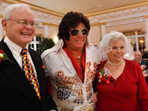 Couples tied the knot or renewed their vows at a mass wedding ceremony on Valentine's Day orchestrated by Adelphia Restaurant in Deptford. An Elvis impersonator officiated the wedding service.