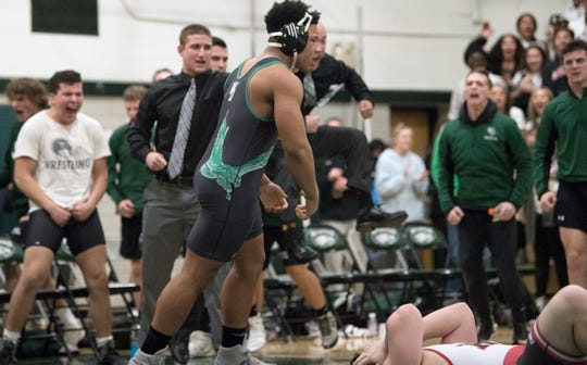 West Deptford's Tion Cherry reacts after pinning Haddonfield's Daniel Flood in 16 seconds during the 285 lb. bout of the South Jersey Group 2 wrestling final held at West Deptford High School on Friday, February 14, 2020.