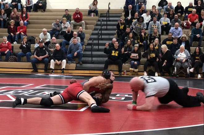 Kingsway's Dakota Morris pins Ronald McCoy at 145 pounds for the Dragons' first win in a 46-19 victory over Moorestown in Friday night's South Jersey Group 4 championship.